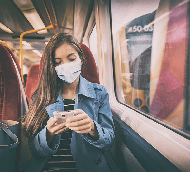 Women wearing a mask on public transport.