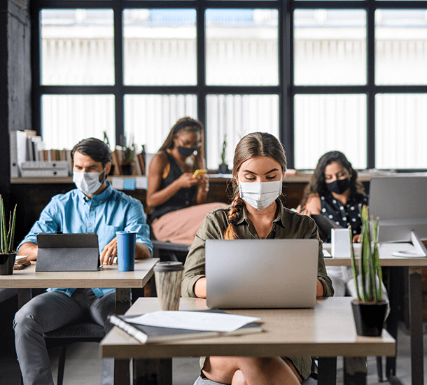 Business people working with masks in an office during COVID-19