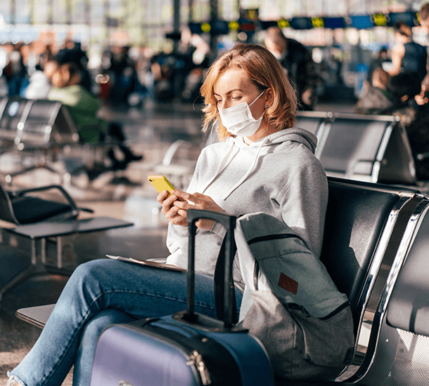 Women wearing a mask in an airport during COVID-19